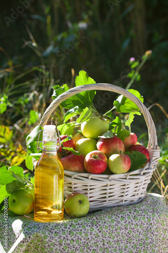 Valokuvatapetti Basket with apples cider juice or vinegar in glass bottle