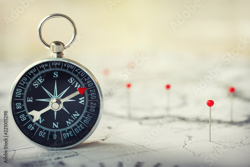 Poster Northern Europe Magnetic compass on world map.Travel, geography, navigation, tourism and exploration concept background. Macro photo. Very shallow focus.
