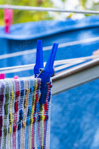 Fotografie, Obraz  Towels that were freshly laundered hang to dry on the clothesline and were fastened with clothespins