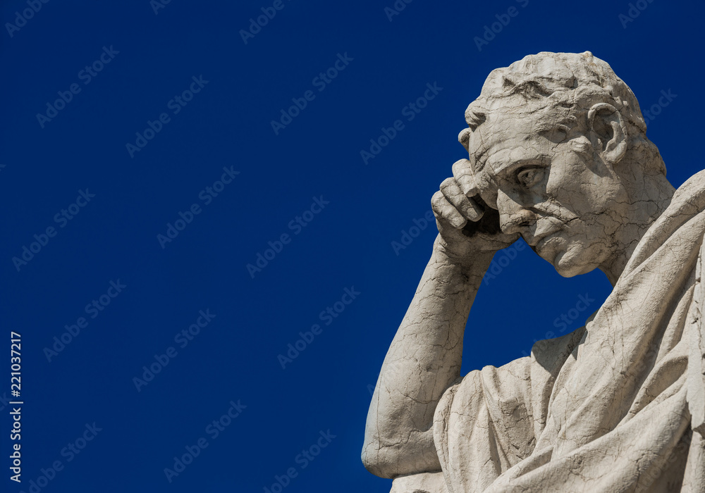 Fototapety, obrazy: Man statue in the act of thinking against blue sky. Ancient Roman Julian the Jurist statue erected at the end of 19th century in front of the Old Palace of Justice in Rome (with copy space)