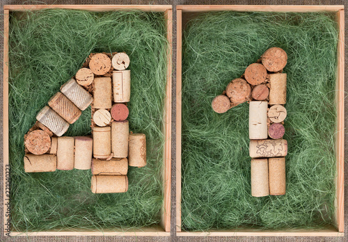 Fotografia  Number 41 forty one  made of wine corks on green background in wooden box
