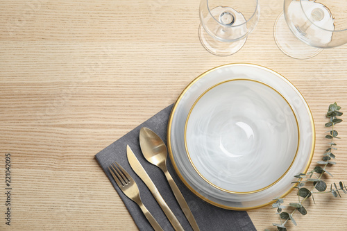 Elegant table setting and space for text on wooden background, top view