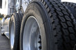 canvas print picture - Big rig semi truck with huge wheels with tires