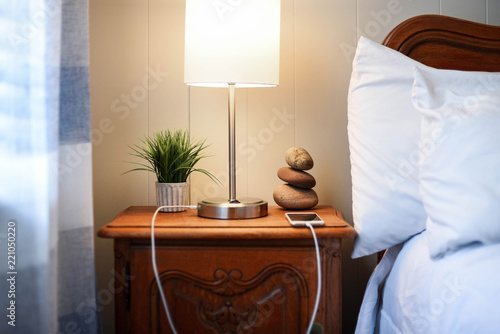 Leinwand Poster Nightstand with smartphone charging - finding balance concept