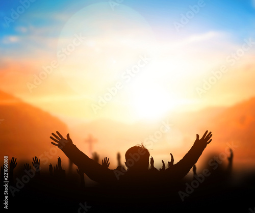 Praise and worship concept:Silhouette of Christian prayers raising hand while pr Wallpaper Mural