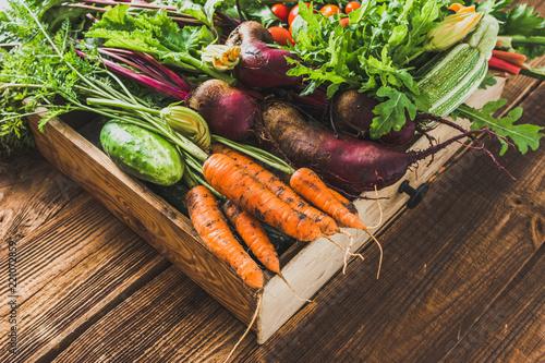 Fresh vegetable, organic produce on farmer market. Vegetables in the box on wooden table.