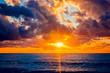 Leinwandbild Motiv Colorful sunset over ocean
