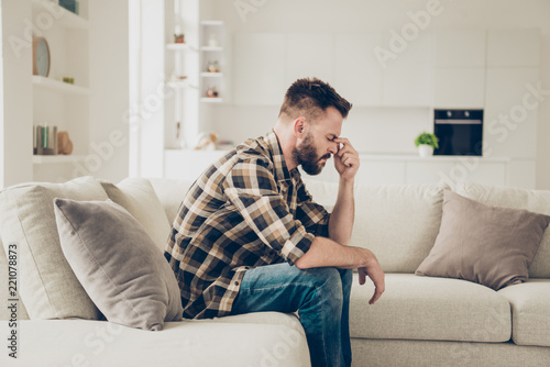 Side view photo of pensive man in stylish brown checkered shirt