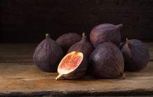 Ripe Figs On Old Wooden Table