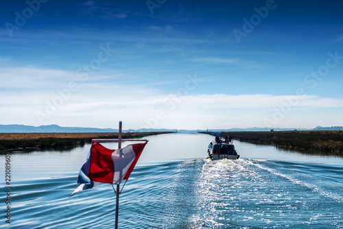 Foto op Canvas Zuid-Amerika land Peruvian flag and recreational flag on a boat on Lake Titicaca in Peru