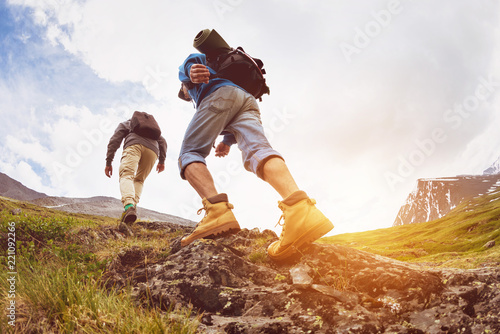 Trekking concept two tourists walking mountains