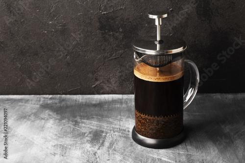 Billede på lærred Coffee in french press on dark background