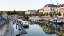 River Meuse In Verdun With Boats On A Summer Evening