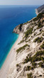 Aerial drone photo of iconic paradise beach of Egremni with white rock steep cliff and emerald clear sea, Lefkada island, Ionian, Greece