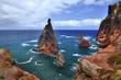 High cliffs with rocks in ocean on coast of Madeira island at Ponta de Sao Lourenco, Portugal