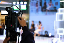 Video Production Camera Recording Live Event On Stage. Television Social Media Broadcasting Seminar Conference.