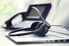 Headset Headphones Telephone And Laptop In Call Center