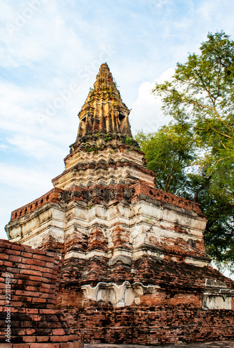 The old tower built of bricks is damaged at Worachet temple in Ayutthaya ,Thailand.