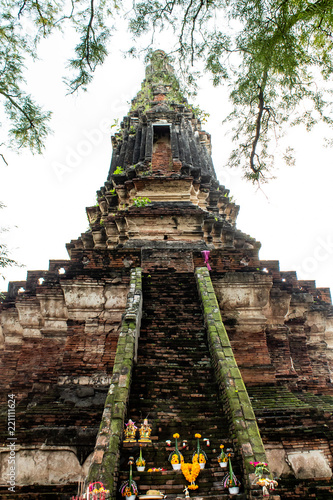 Spoed Foto op Canvas Bedehuis The old tower built of bricks is damaged at Worachet temple in Ayutthaya ,Thailand.