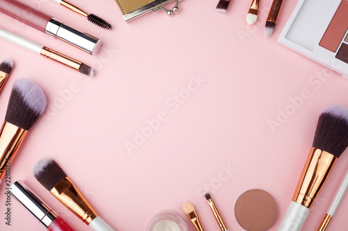 Obraz Fashion Makeup Cosmetic accessories on pink background. Top view. Flat lay. - fototapety do salonu