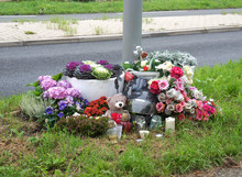 Memorial Site With Flowers On The Side Of The Road To Honor The Victim Of A Traffic Accident