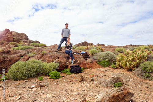 Mature tourist couple in rugged landscape, portrait, Las Palmas, Gran Canaria, Canary Islands, Spain