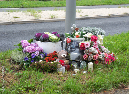 Memorial site with flowers on the side of the road to honor the victim of a traf Wallpaper Mural