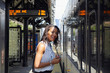 Businesswoman standing close to train