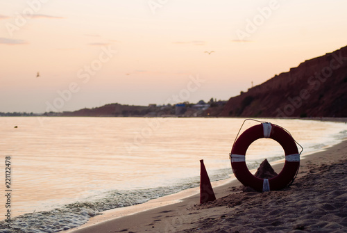 Poster Oceanië Vintage red mouthpiece and a life preserver,