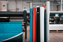 Big Rolls Of Vinyl And Glossy Premium, Quality Paper Ready For Big Printer Supply And Delivery. Tubes And Colors In Plotting Facility.