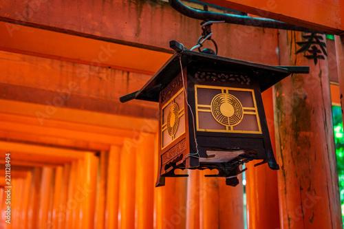 Traditional Japanese Wooden Lantern On A Red Torii Pillar In Fushimi