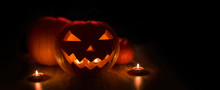 Halloween And Holidays Concept - Spooky Carved Pumpkin Jack-o-lantern With Candles In Darkness