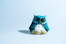 Funny Wooden Owl Toy In A Multitude Of Colors On A White Background