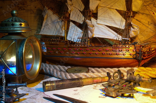 Keuken foto achterwand Schip Sailboat, ship lantern, compass, old coins and sextants. Travel and marine engraving background. Retro style.