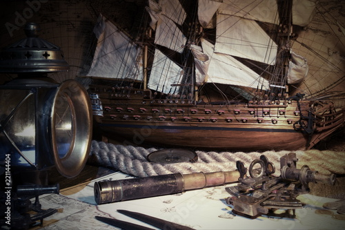 Sailboat, ship lantern, compass, old coins and sextants. Travel and marine engraving background. Retro style.