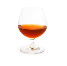 Wineglass With Cognac Isolated...