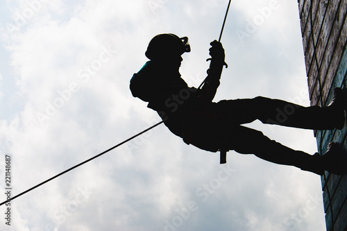 Silhouette High angle view of rappelling Canvas Print
