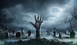 canvas print picture Zombie Hand Rising Out Of A Graveyard In Spooky Night