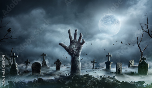 Zombie Hand Rising Out Of A Graveyard In Spooky Night Fototapet