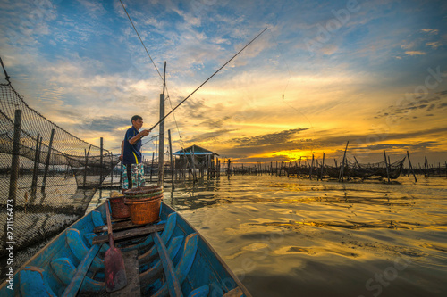 Traditional colorful asian fishing boats in fishing village