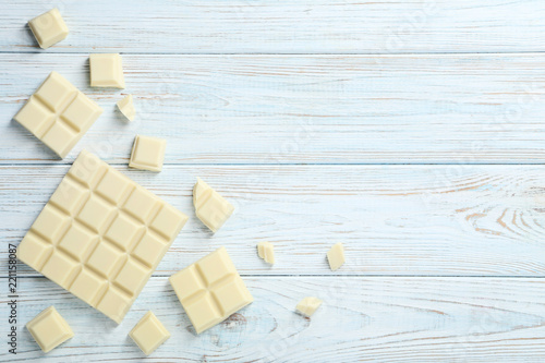 White chocolate pieces on wooden table