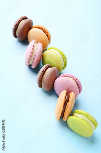 Colorful macarons on mint background