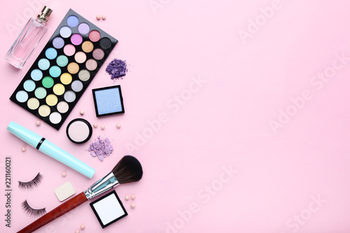 Different makeup cosmetics with perfume bottle on pink background Fototapet