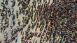 Aerial top view of a crowd people at the square. Mass gathering of people.