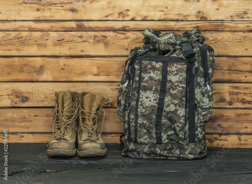 military backpack on a wooden table
