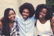 canvas print picture - Laughing african american hipster man with two beautiful woman