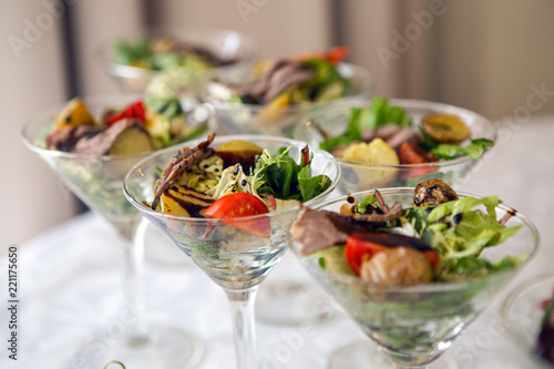 triangular Martini glass with a vegetable salad