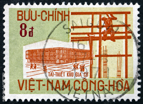 Fotografia  Postage stamp Vietnam 1970 New building and scaffold