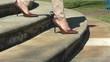 Woman in high heels walking steps outdoor