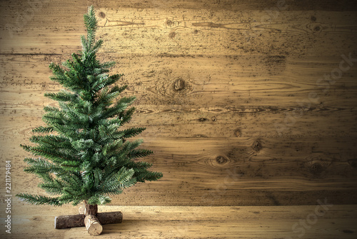 Fotomural  Green Christmas Tree On Brown Rustic Background